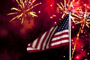 bigstock-July--Flag-and-fireworks-5392835